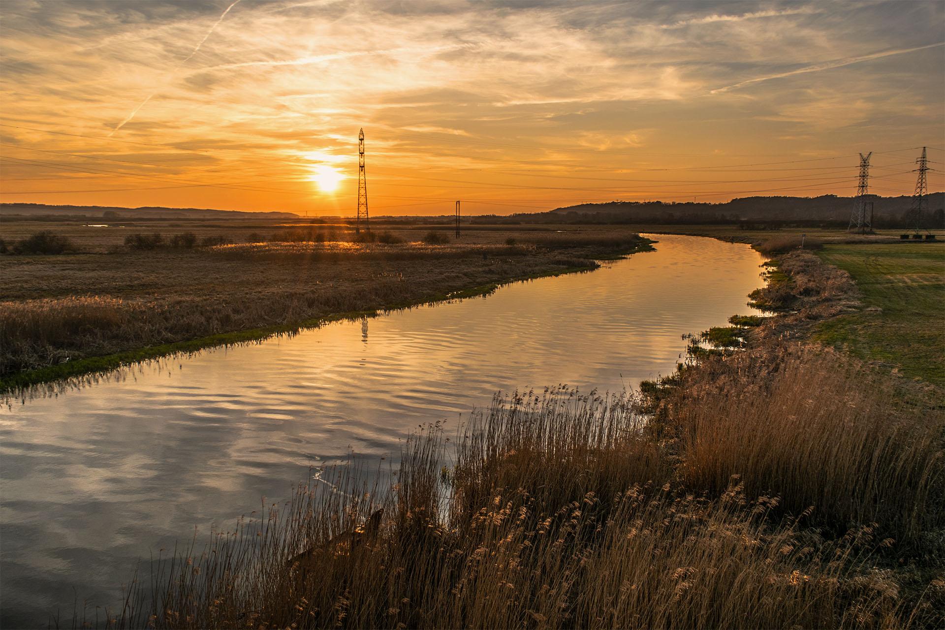 Zachód słońca nad Notecią, oglądany z mostu między Krzewiną i Milczem. Fot. Marcin Maziarz