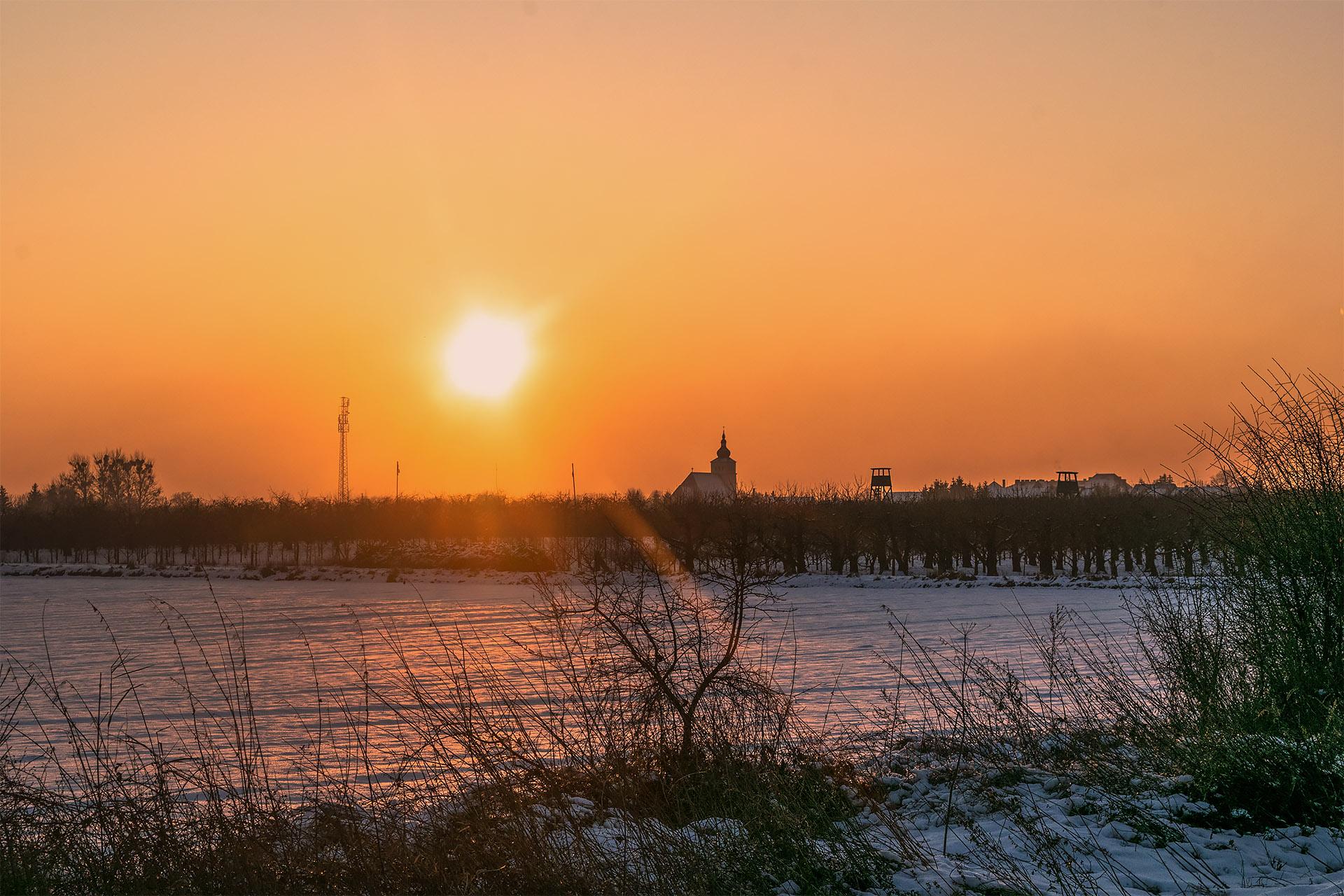 Słońce zachodzące nad Białośliwiem. Fot. Marcin Maziarz